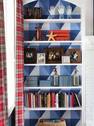 add graphic pop to a bookcase with wallpaper graphic wallpaper