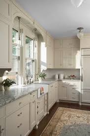 white kitchen cabinets with window trim and white kitchens happy or stroke of genius