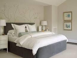 cascading chandelier over blue velvet arch bed transitional
