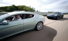 porsche family car 2010 aston martin rapide vs 2010 porsche panamera turbo