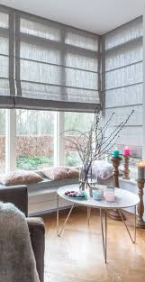 the ultimate guide to blinds for bay windows window bay windows love the grey roman shades