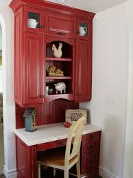 painted a bold red the country style desk seamlessly transitions
