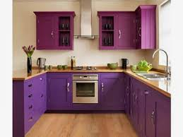 black countertop and purple wall decor for kitchen ideas kitchen
