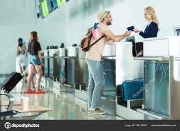 man at check in desk at airport u2014 stock photo arturverkhovetskiy