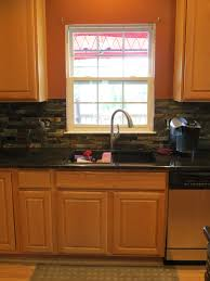 peal and stick backsplash black countertops with white cabinets