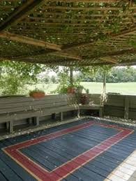 Outdoor Area Rugs For Decks How To Paint An Area Rug With Stencils On An Outside Deck