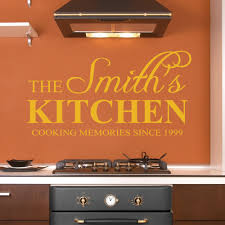 personalised kitchen wall stickers decals orange personalised kitchen wall decal behind a cooker