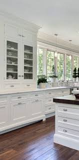 kitchen kitchen in luxury home with white cabinetry white