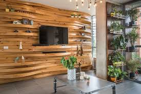 curved wood wall a wavy wood accent wall creates shelves in this apartment