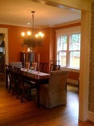 gorgeous dining room combination of orange coral with a pale