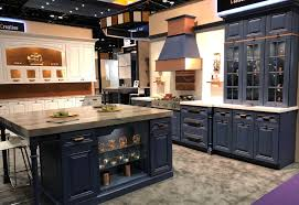 installing a kitchen base cabinet 4 frequently asked cabinet installation questions answered