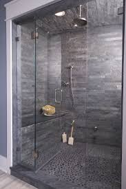 wow love this dark stone shower cave pebble flooring and