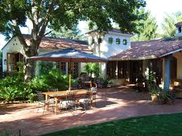 southwestern style home decor lush landscaping and a generous red brick patio distinguish this
