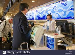 man at united airlines check in counter honolulu international