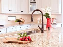 white kitchen cabinets with granite countertops photos giallo ornamental granite countertops add elegance in the