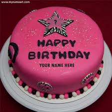 write name on pink birthday cake with year wishes greeting card