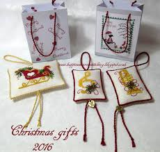 happiness is cross stitching ornaments finished