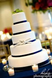 nautical theme wedding cake with gold and custom anchor