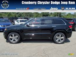 light green jeep cherokee 2014 jeep grand cherokee overland 4x4 in black forest green pearl