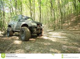 monster trucks in mud videos off road big wheeled monster truck in mud forest stock photography