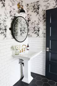 black tile floor and white subway tile for bathroom remodel in