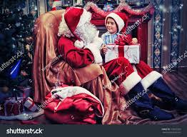 santa claus giving present little cute stock photo 117672529