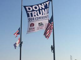 Flag Pole Express Political Activists Scale Rock Hall Flag Poles To Hang 600 Foot