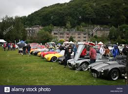 Classic Sports Cars - row of classic vintage sports cars at show outdoors in the rain