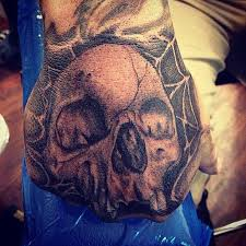 black and gray skull with spider web big gus