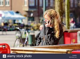 in long hair lund sweden april 11 2016 blond woman in long hair talking in