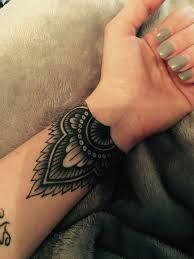 the 25 best cuff tattoo ideas on pinterest henna tattoo wrist