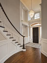 Foyer by This Stunning Foyer Features Light Gray Walls Paired With Dark
