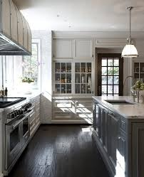 white kitchen cabinets dark tile floor outofhome