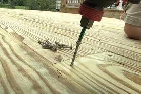 how to fasten pressure treated decking fine homebuilding