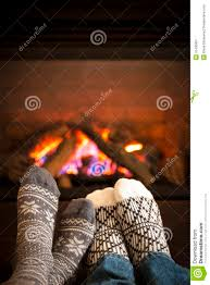 feet warming by fireplace royalty free stock photography image