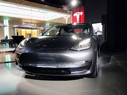 tesla model 3s are starting to show up in stores for the first