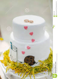 white wedding cake with gold rings stock photo image 60871104