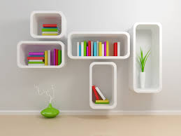 white alphabet shaped bookshelves in white wall paint decorating