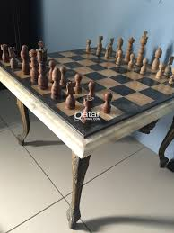 marble chess board table with wooden chess pieces qatar living