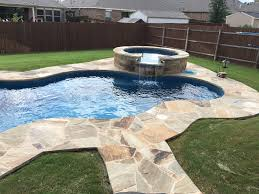 Nebula and Neptune Spa with custom swimming pool deck stone work