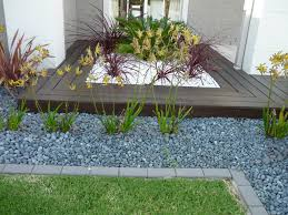 exterior clean backyard landscaping with mexican beach pebbles