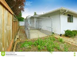 one story house exterior fenced backyard view with cage stock one story house exterior fenced backyard view with cage
