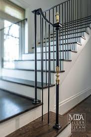 black staircase with gold finials transitional entrance foyer