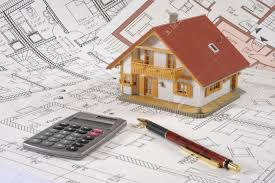 house building plan with hand calculator stock photo picture and