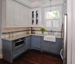 different height upper cabinets kitchen traditional with wood trim