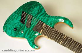 9 string fanned fret custom 9 string guitar teal quilted maple