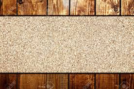 cork board at wooden panel wall interior background stock photo
