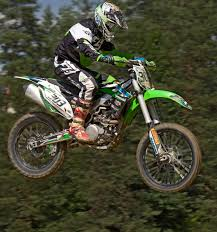 black motocross bike person riding on green motocross dirt bike free image peakpx
