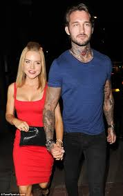 waring with tattooed hunk as she steps out for dinner date