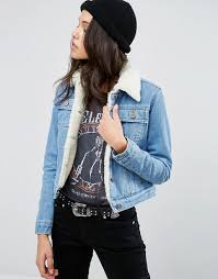 light blue cropped jean jacket asos denim cropped jacket in blue with borg non stretch denim light